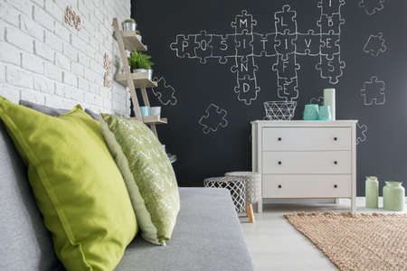 Living Room With White Dresser, Sofa And Blackboard Wall Stock ...