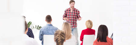 manager team: Charismatic young manager delivering a motivation speech to his team members Stock Photo