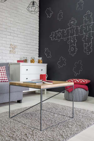 red color: Living room with table, sofa, dresser and blackboard wall Stock Photo