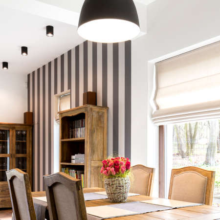 vintage furniture: Stylish modern dining room with vintage wooden furniture Stock Photo