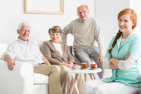 common room: Comfortable nursing home with smiled seniors