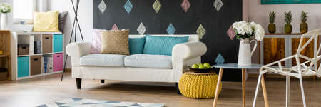 contemporary living room: Scenic contemporary cosy living room in pastel colours with exotic details