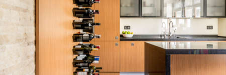 wall mounted: Luxurious wooden kitchen with wall mounted wine rack