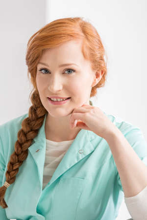 common room: Portrait of a red-haired, young nurse Stock Photo