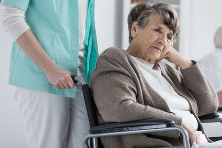 nursing care are for seniors: Thoughtful senior woman on a wheelchair
