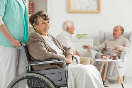 common room: Seniors at recreation room at nursing home