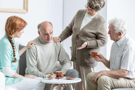 common room: Elder people talking at nursing home Stock Photo