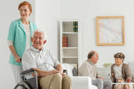 nursing care are for seniors: Common room at nursing home with seniors