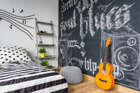 unisex: Unisex teenager interior with chalkboard graffitti and guitar
