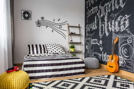 bedroom: Monochrome bedroom interior for young guitar musician