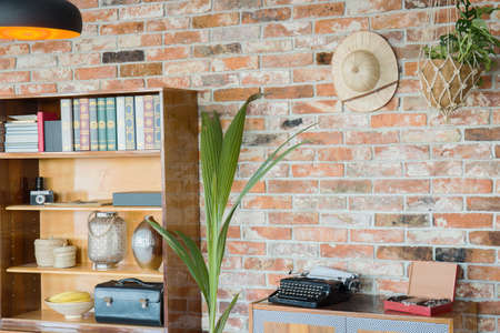 antique vase: Wooden rack at the brick wall background