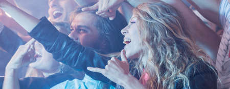 celeb: Long-haired woman shouting during the rock concert Stock Photo