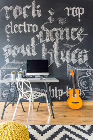 hassock: Decorative graffiti on chalkboard wall in teenage room Editorial