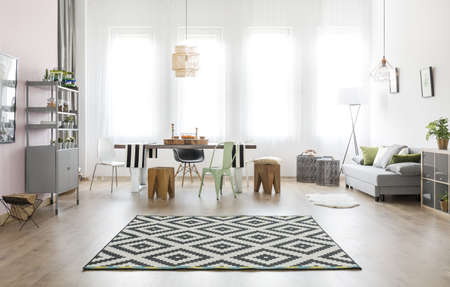 Multifunctional room with table and comfortable sofa