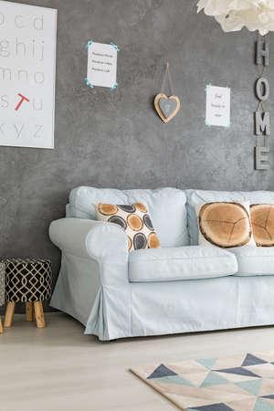 living room sofa: Blue sofa in modern grey living room