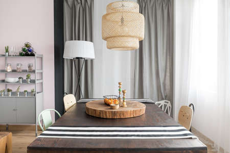 Interior with dining table, lamp and rack