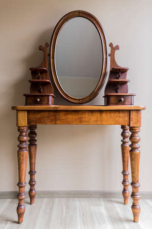 dressing table: Renovated vintage dressing table made of wood with oval mirror