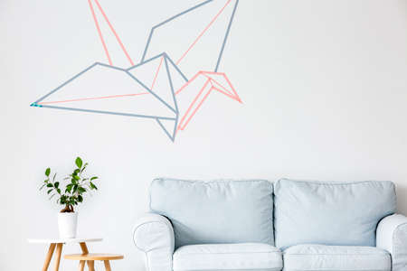 living room wall: Origami crane vector graphic on the wall in living room