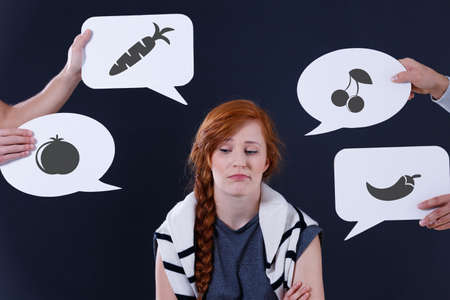 Bored girl and speech balloons with fruits and vegetables images