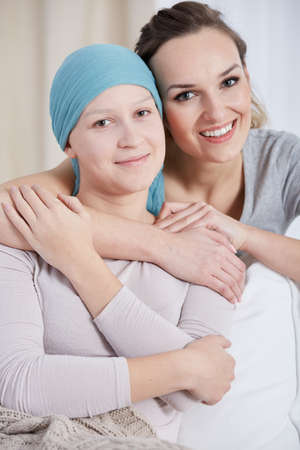 Young, happy cancer woman and her caring sister Stock Photo