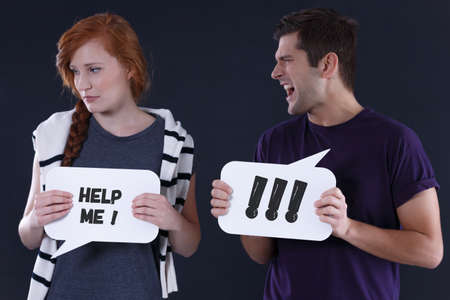 alienation: Shouting man and stressed girl holding speech balloons