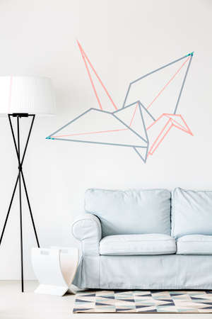 ides: DIY wall decoration- creative origami crane on the wall Stock Photo