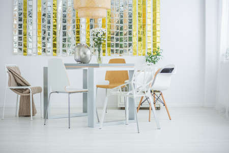 communal: Room with communal table, chairs and wall decor Stock Photo