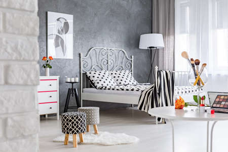 dressing table: Grey and white modern womans bedroom with dressing table