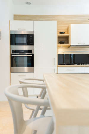 integral oven: Modern kitchen with integral oven, microwave, built-in cabinets in scandinavian style Stock Photo