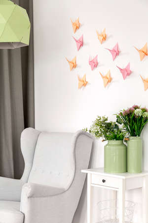 pleasure craft: 3d decoration- colorful paper origami crane on the wall Stock Photo