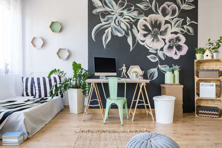 floral decoration: Cozy stylish bedroom with floral decoration on a black board