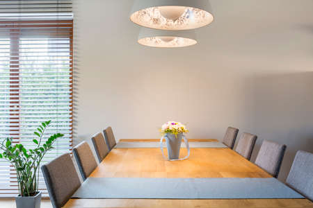 white interior: Home interior with wooden dining table, chairs and pendant lamp