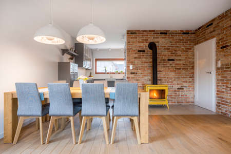 industrial design: Dining area with wood table and upholstered chairs