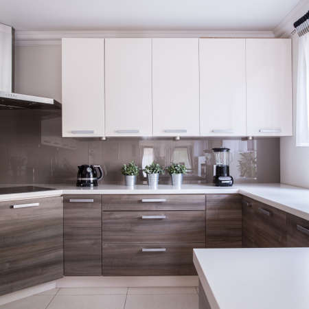 cabinets: Modern and wooden cabinets in the kitchen
