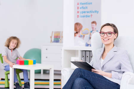 Woman therapist leading occupational therapy for children with ADHD Stock Photo