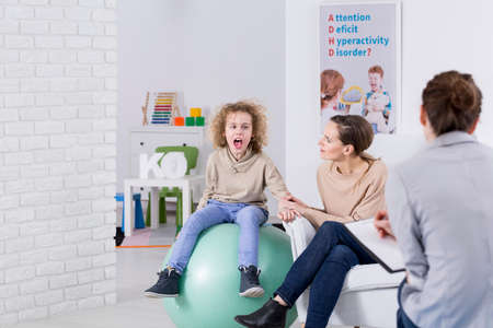 Mother and her child with ADHD during therapy