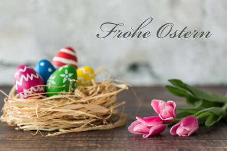 Easter card with decorated eggs and pink tulips Stok Fotoğraf - 70451522