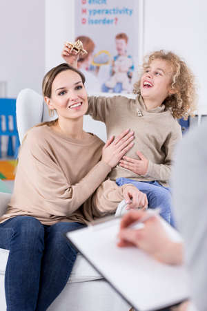 hyperactivity: Conscious mother taking care of her child with ADHD Stock Photo