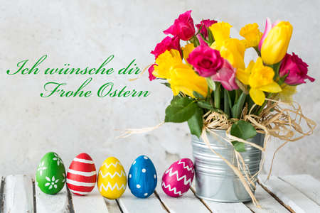 Card with easter eggs and spring flowers in metal bucket
