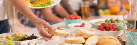 Outdoor party table with fresh home-made food for summer grill party Stock Photo