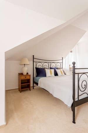 bedside: Attic, modern designed bedroom with marital bed and bedside cabinet
