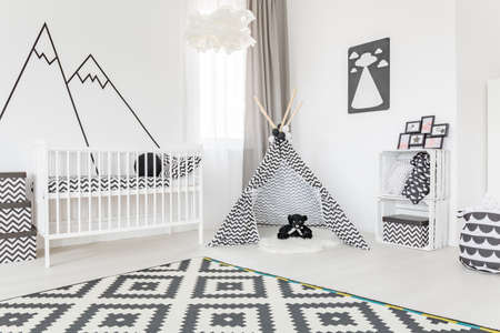 Spacious baby room with a tipi in the middle