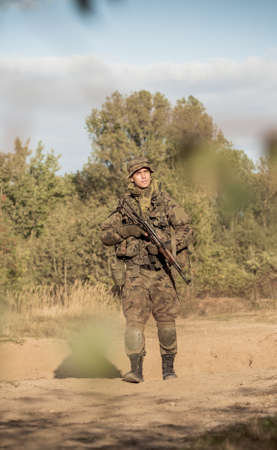 rigor: Soldier with a gun walking alone on the training ground