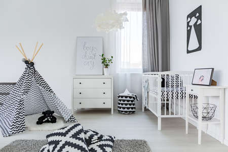 Bright baby room in nordic style with tipi