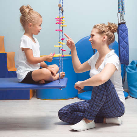 Physical and mental activities for a kid during sensory integration therapy Stock Photo