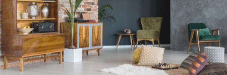 old furniture: Traveller room with old furniture, red brick wall and houseplants