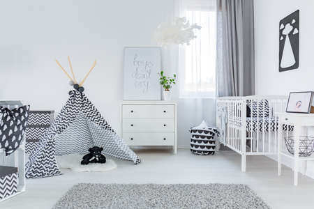 Modern baby room with stylish, white furniture
