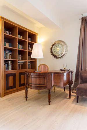 hause: Classic elegant interior with wooden, antique desk, chair and bookshelf
