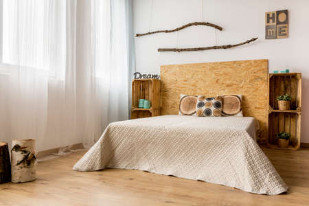 Minimalistic bright bedroom with double bed in ecological style Stock Photo