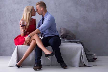Blonde woman in high heels on the date with young man
